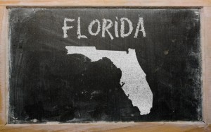 outline map of us state of florida on blackboard